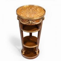 A circular mahogany gueridon in manner of Zwiener - 1837483