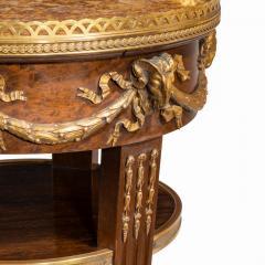 A circular mahogany gueridon in manner of Zwiener - 1837485