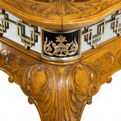 A fine walnut and burr walnut Orientalist centre table - 1115822