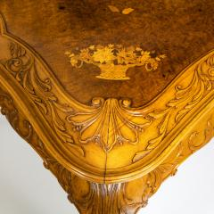 A fine walnut and burr walnut Orientalist centre table - 1115823