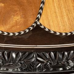 A large Anglo Ceylonese ebony and specimen wood centre table circa 1840 - 1905403