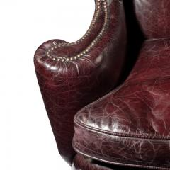 A large George I style burgundy leather wing arm chair - 1176026
