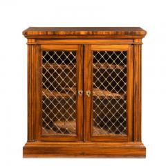 A late Regency Gon alo Alves two door side cabinet attributed to Gillows - 1188206