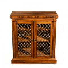 A late Regency Gon alo Alves two door side cabinet attributed to Gillows - 1188207
