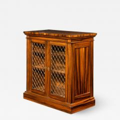 A late Regency Gon alo Alves two door side cabinet attributed to Gillows - 1188257