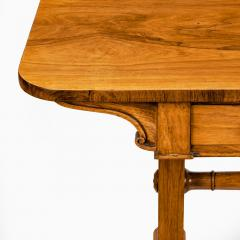 A late Regency rosewood end support table Gillows or Holland and Sons - 1851619