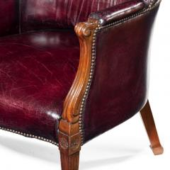 A pair of barrel backed Mahogany wing arm chairs - 1219282
