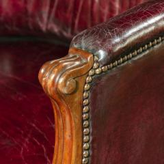 A pair of barrel backed Mahogany wing arm chairs - 1219287