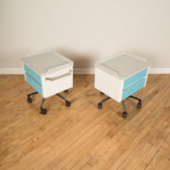 A pair of white and blue two drawers side cabinets on rolling base 1970s - 2129097