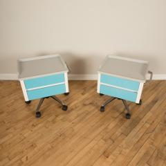 A pair of white and blue two drawers side cabinets on rolling base 1970s - 2129099