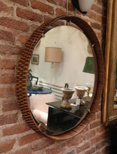 A rattan and brass wall mirror Italy 50 - 776614