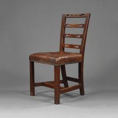 A set of six George III oak dining chairs - 929443