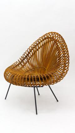 A stylish rattan and iron chair designed by Janine Abraham  - 1857157