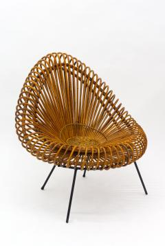 A stylish rattan and iron chair designed by Janine Abraham  - 1857158