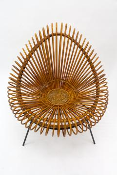 A stylish rattan and iron chair designed by Janine Abraham  - 1857168