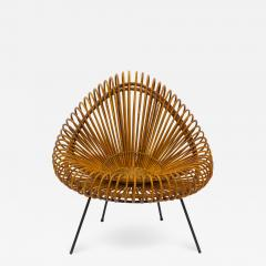 A stylish rattan and iron chair designed by Janine Abraham  - 1858008