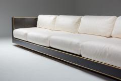 Alain Delon Maison Jansen geometric sofa in Black and Brass Hollywood Regency 1970s - 2048351