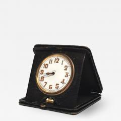 An Art Deco Travel Clock in Green Leather - 337096