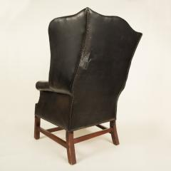 An English leather button back wing chair with mahogany frame circa 1940 - 2007555