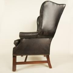 An English leather button back wing chair with mahogany frame circa 1940 - 2007558