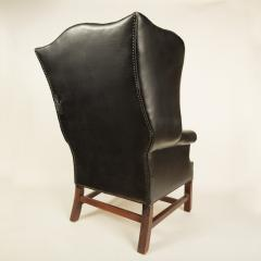 An English leather button back wing chair with mahogany frame circa 1940 - 2007561