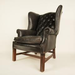 An English leather button back wing chair with mahogany frame circa 1940 - 2007563