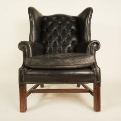 An English leather button back wing chair with mahogany frame circa 1940 - 2007564