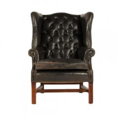 An English leather button back wing chair with mahogany frame circa 1940 - 2007594