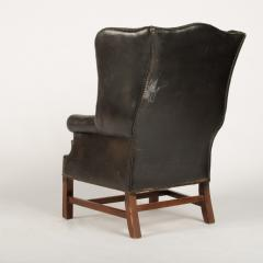 An English leather button back wing chair with mahogany frame circa 1940 - 2007599