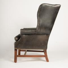 An English leather button back wing chair with mahogany frame circa 1940 - 2007600