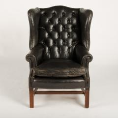 An English leather button back wing chair with mahogany frame circa 1940 - 2007602