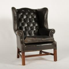 An English leather button back wing chair with mahogany frame circa 1940 - 2007612
