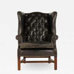 An English leather button back wing chair with mahogany frame circa 1940 - 2009847