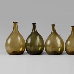 An Exceptional Set of 13 Graduated Blown Chestnut Bottles - 307790