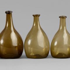 An Exceptional Set of 13 Graduated Blown Chestnut Bottles - 307792
