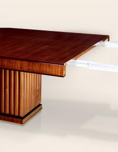An Extendable Dining Table with Fluted Base by Iliad Design - 453796