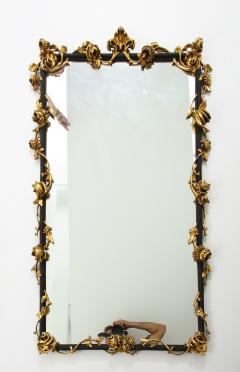 An Italian Rococo style giltwood and black painted wall mirror - 1145173