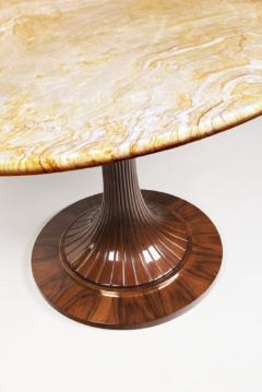 An Oval Pedestal Table by ILIAD Design - 703053