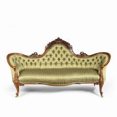 An elaborate Victorian shaped walnut sofa - 1846403