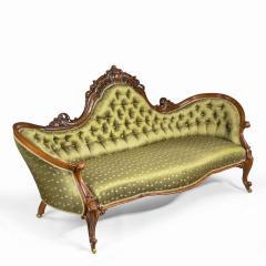 An elaborate Victorian shaped walnut sofa - 1846404