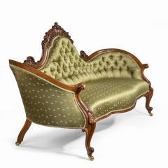 An elaborate Victorian shaped walnut sofa - 1846405