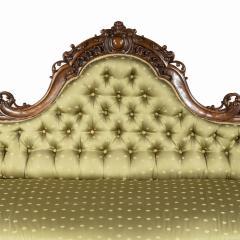 An elaborate Victorian shaped walnut sofa - 1846407