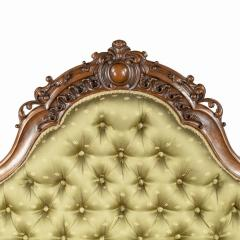 An elaborate Victorian shaped walnut sofa - 1846408