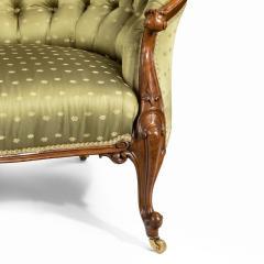 An elaborate Victorian shaped walnut sofa - 1846410