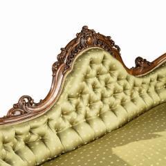 An elaborate Victorian shaped walnut sofa - 1846412