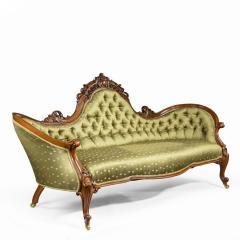 An elaborate Victorian shaped walnut sofa - 1846413