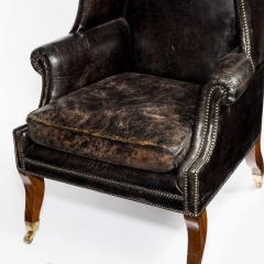An unusual Regency mahogany sabre leg arm chair - 790548