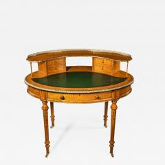 An unusual Victorian freestanding oval satinwood desk - 1636415