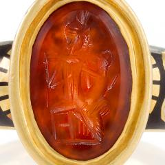 Antique Black White Enamel and Gold Ring featuring a Red Intaglio Carving - 1049229