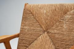 Armchair in Solid Oak and Cane Denmark ca 1960s - 1317669